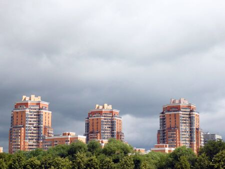 lowering: building and lowering clouds at day