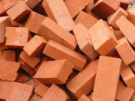 heap of red brick at day