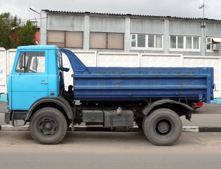 blue truck on asphalt road photo