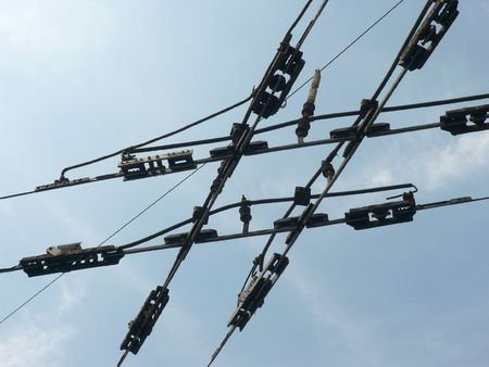 tramway:  tramway network wire  crossing on sky background Stock Photo