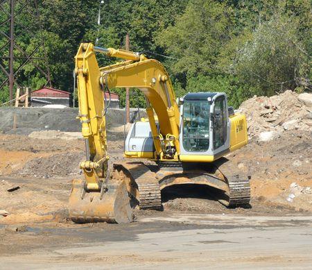 track-type excavator on ground at day photo