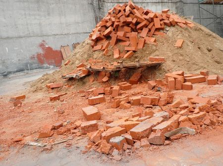 heap of red brick at day photo