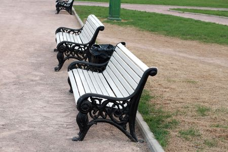bench  in city park at spring photo