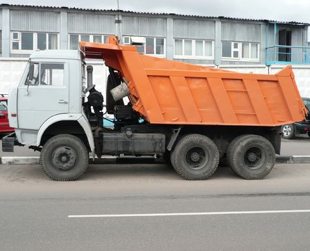 orange truck on asphalt road   photo