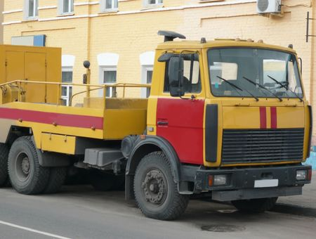 red-yellow emergency truck on asphalt road   photo