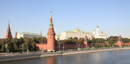 Moscow Kremlin tower,  quay and river  photo