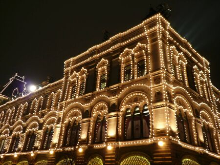 old building at night with illumination photo