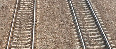 railway at day on gravel background photo