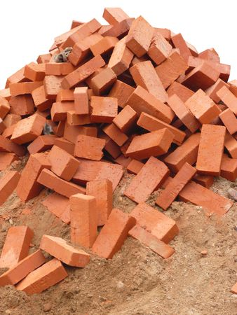 heap of red brick on white background photo