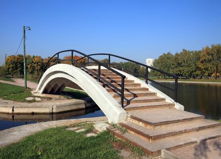 handhold: bridge over pond with handhold Stock Photo