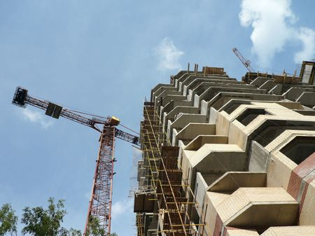 house develop with crane tower photo