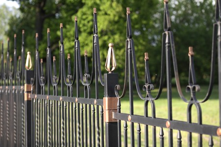 fence with gold decoration at day photo