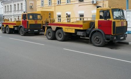 red-yellow emergency truck on asphalt road Stock Photo - 7373540
