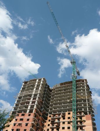 house develop with crane tower at day photo