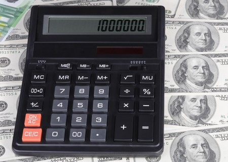 100 dollar, euro banknote and calculator Stock Photo - 7410744