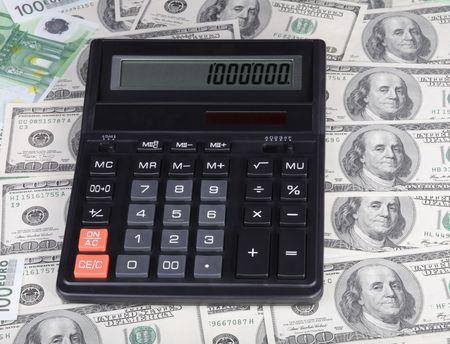 million fish: 100 dollar, euro banknote and calculator