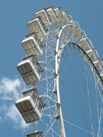 Ferris wheel at sunny day photo