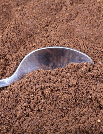 milled: milled coffee  and teaspoon Stock Photo