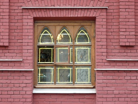 red brick wall with window at day photo