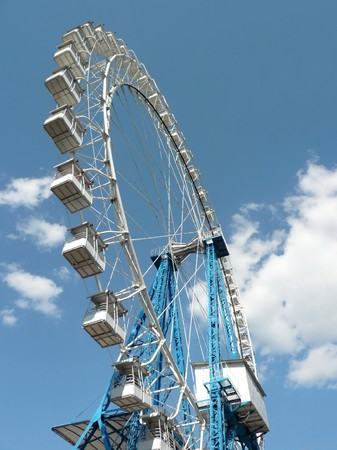 Ferris wheel n park at sunny day photo