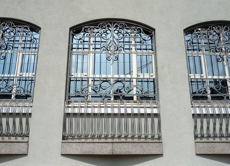 lattice window: windows of building with grid at day Stock Photo