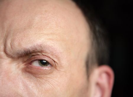 one eye of alone man photo