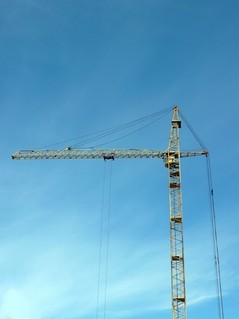 one crane tower at day photo