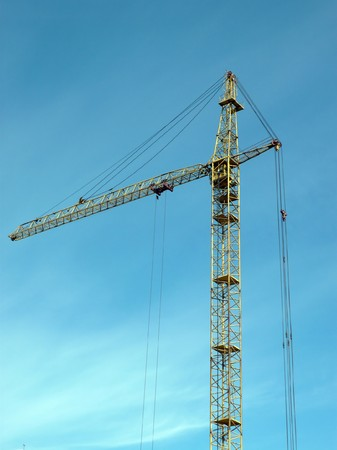crane tower on sky background at day photo