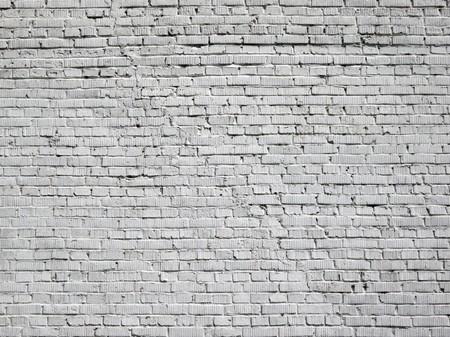 grey brick wall background at day photo