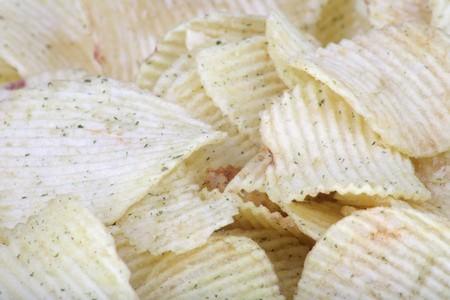 serrate: many of potato chips horizontal  texture Stock Photo