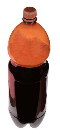 kvass in bottle with brown cup isolated photo