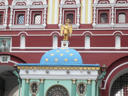 old building with gold religious monument photo