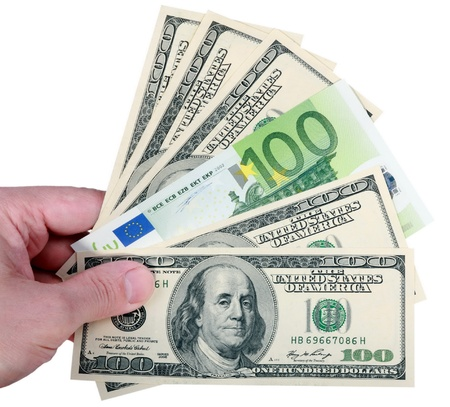 hand with dollar and euro on white background Stock Photo - 8618485