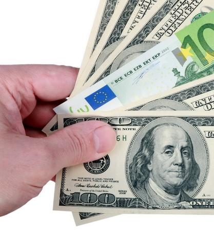 hand with dollar and euro on white background Stock Photo - 8708266