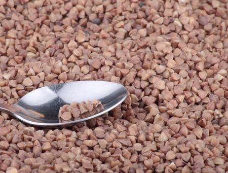 buckwheat background and one teaspoon photo