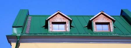 green roof on on house with wood garret Stock Photo - 9168617