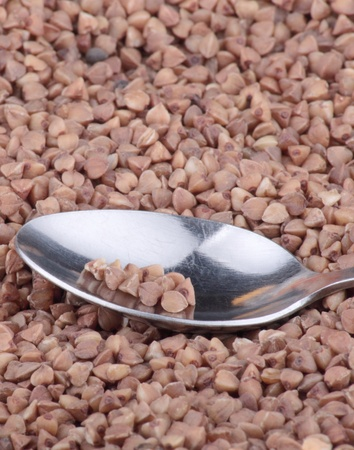 buckwheat background and one teaspoon photo