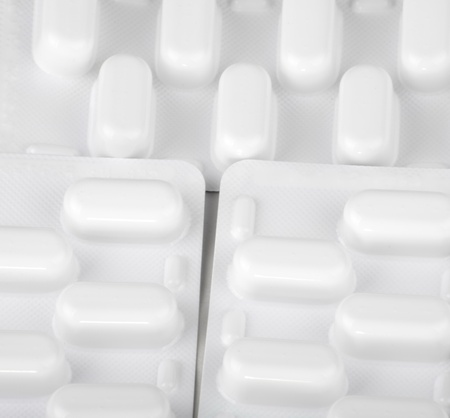 many tablets in blister background photo