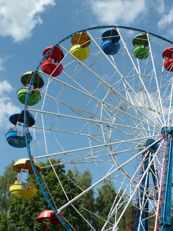 Ferris wheel at dry sunny summer day photo