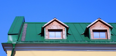 green roof on on house with wood garret Stock Photo - 9469246