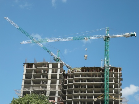 house develop at day  with crane  in city photo
