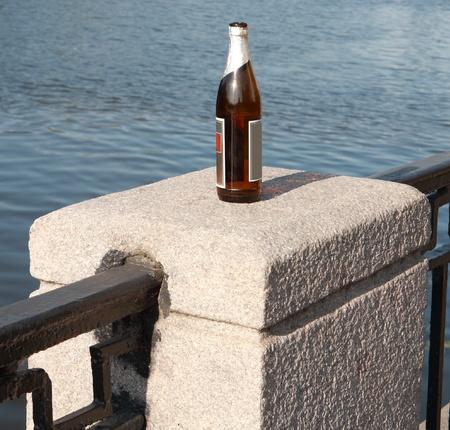 bottle on fence stone  column photo