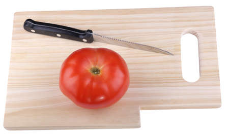 wood kitchen board with knife and tomato photo