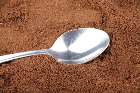 milled: milled coffee and one teaspoon  Stock Photo