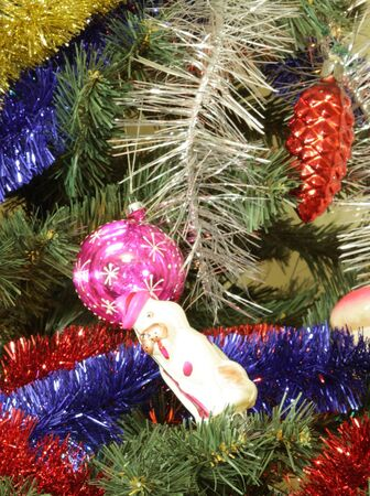 many of toys on green christmas fir  photo