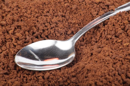 milled: many of milled coffee and teaspoon