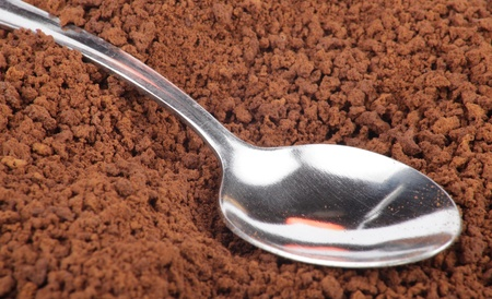 many of milled coffee and teaspoon  photo