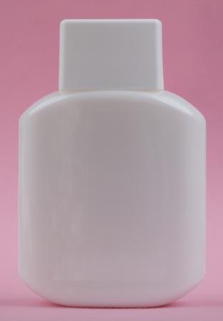 vesicle: perfumery bottle on pink background