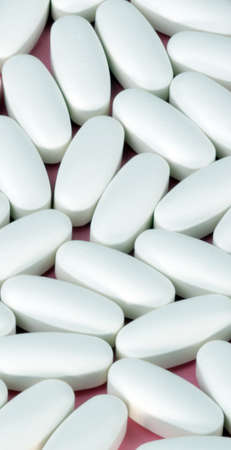 white pill on pink background Stock Photo - 11892450