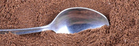 milled coffee background  and teaspoon photo